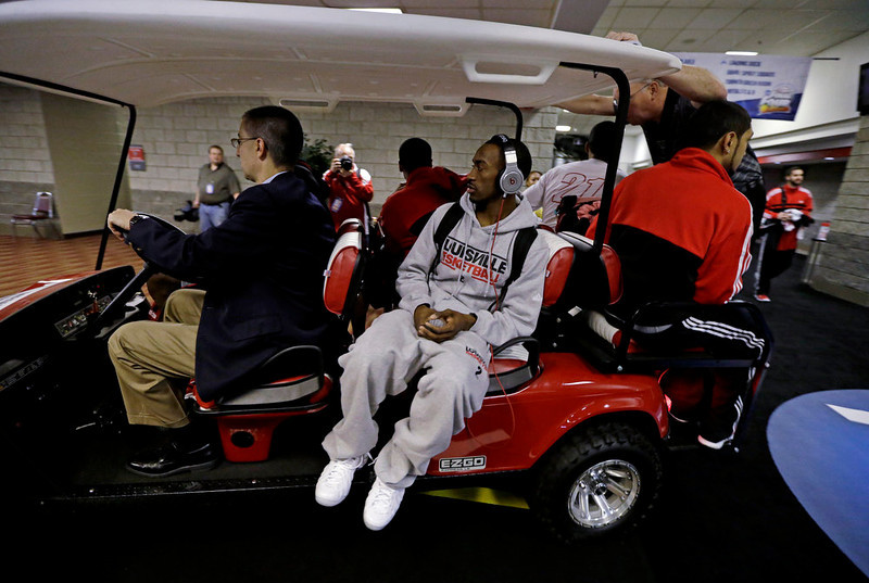 . Louisville\'s Russ Smith rides a golf cart to a news conference for their NCAA Final Four tournament college basketball game Sunday, April 7, 2013, in Atlanta. Louisville plays Michigan in the championship game on Monday. (AP Photo/Charlie Neibergall)