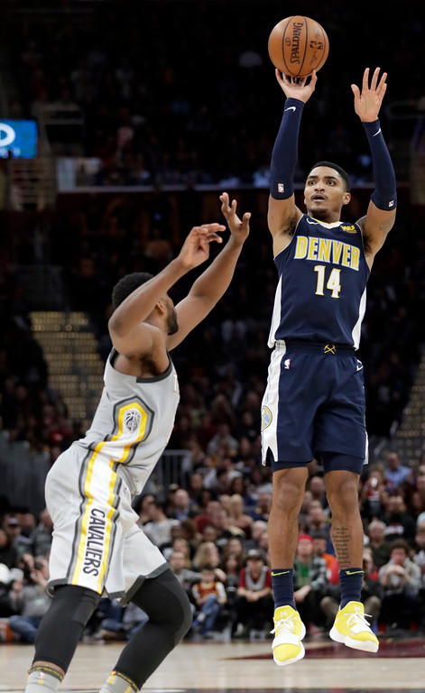 . Denver Nuggets\' Gary Harris (14) shoots over Cleveland Cavaliers\' Tristan Thompson (13) in the second half of an NBA basketball game, Saturday, March 3, 2018, in Cleveland. The Nuggets won 126-117. (AP Photo/Tony Dejak)