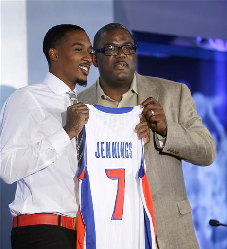 . Detroit Pistons newest acquisition, point guard Brandon Jennings, left, poses with Pistons President of Basketball Operations Joe Dumars after a news conference in Auburn, Hills, Mich., Tuesday, Aug. 6, 2013. (AP Photo/Carlos Osorio)