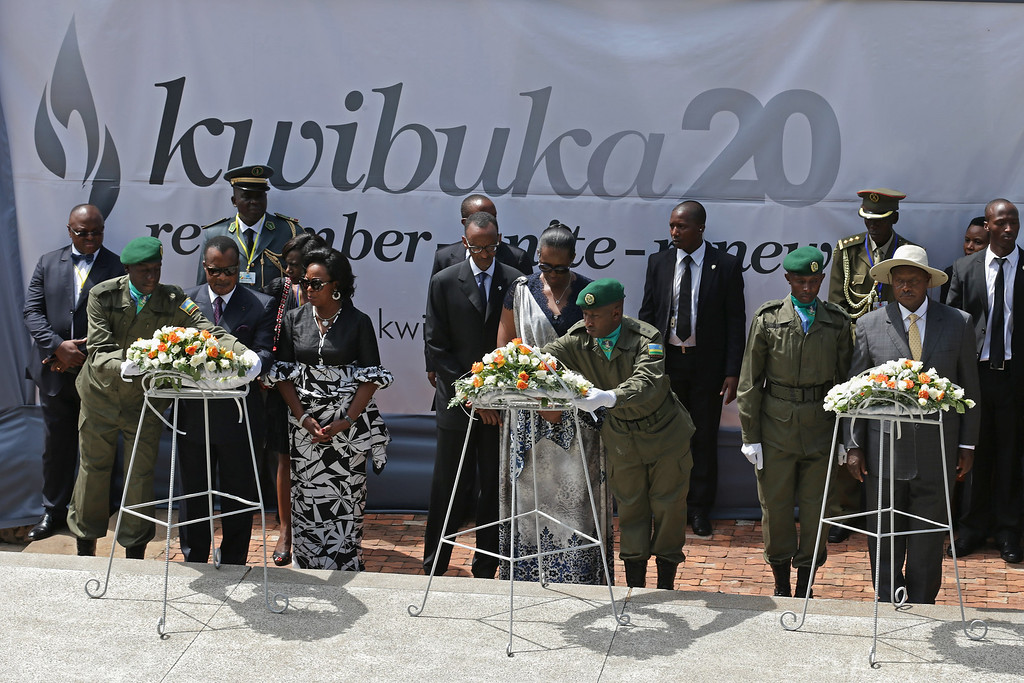 . (L-R) Congo-Brazzaville President Denis Sassou Nguesso and first lady Antoinette Sassou-Nguesso, Rwanda President Paul Kagame and first lady Jeannette Kagame and Uganda President Yoweri Museveni participate in a wreath-laying ceremony at a tomb that holds 250,000 victims of the 1994 genocide during a ceremony at the Kigali Genocide Memorial Center on April 7, 2014 in Kigali, Rwanda.  (Photo by Chip Somodevilla/Getty Images)