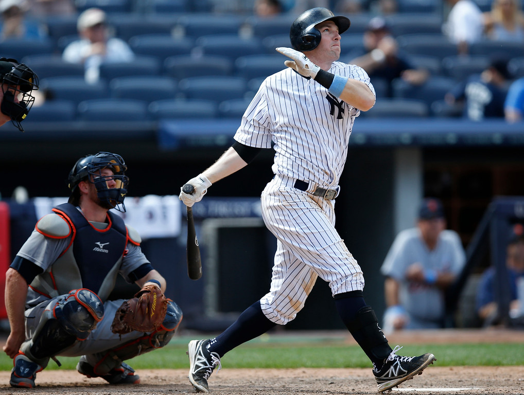 . New York Yankees Stephen Drew hits a ninth-inning solo home run off Detroit Tigers relief pitcher Joakim Soria in the Yankees 12-4 loss to the Tigers in a baseball game at Yankee Stadium in New York, Sunday, June 21, 2015. It was Drew\'s second home run of the game.  (AP Photo/Kathy Willens)