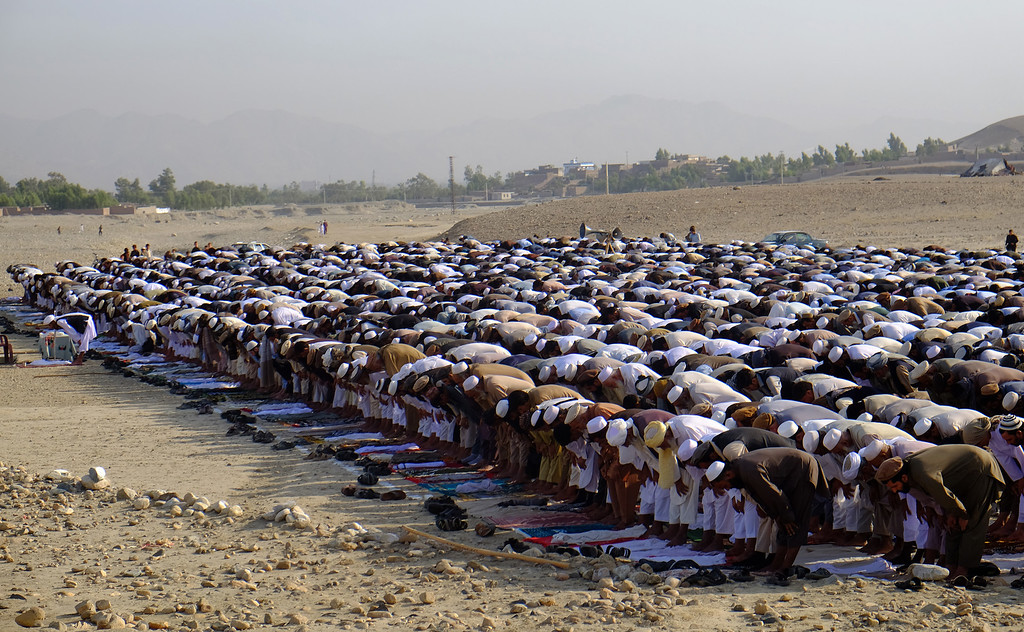 . Afghans offer Eid al-Adha prayers in Jalalabad east of Kabul, Afghanistan, Monday, Sept. 12, 2016. Muslims around the world will celebrate Eid al-Adha in local language, the Festival of Sacrifice, to mark the end of the hajj pilgrimage by slaughtering sheep, goats, cows and camels to commemorate Prophet Abraham\'s readiness to sacrifice his son on God\'s command. (AP Photo/Mohammad Anwar Danishyar)