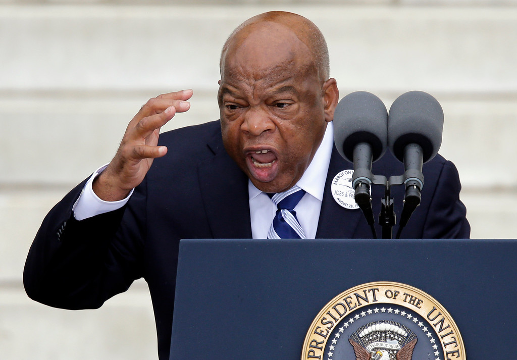 """. Rep, John Lewis, D-Ga. speaks at the Let Freedom Ring ceremony at the Lincoln Memorial in Washington, Wednesday, Aug. 28, 2013, to commemorate the 50th anniversary of the 1963 March on Washington for Jobs and Freedom. It was 50 years ago today when Martin Luther King Jr. delivered his \""""I Have a Dream\"""" speech from the steps of the memorial. (AP Photo/Carolyn Kaster)"""