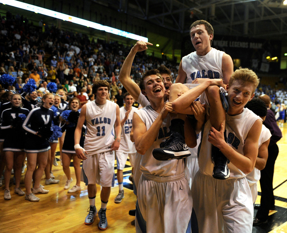 . BOULDER, CO. - MARCH 15: Teammates carried Valor guard Luke Proctor off the court. The Valor Christian High School boy\'s basketball team stunned Broomfield 75-74 Friday night, March 15, 2013 at the Coors Events Center in Boulder.  (Photo By Karl Gehring/The Denver Post)