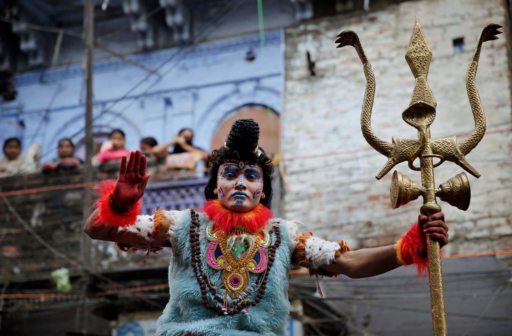 . A Hindu devotee dressed as God Shiva participates in a procession during the ìShivratriî festival, in Allahabad, India, Thursday, Feb. 27, 2014.  (AP Photo/Rajesh Kumar Singh)