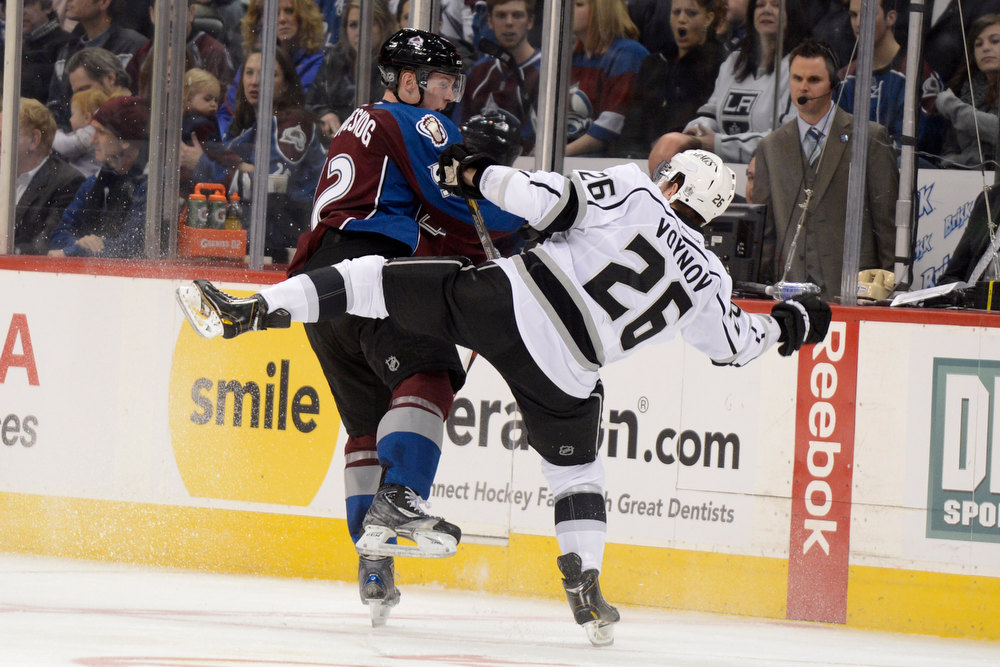 Description of . DENVER, CO. - JANUARY 22: Colorado Avalanche left wing Gabriel Landeskog (92) checks Los Angeles Kings defenseman Slava Voynov (26) during the third period. The Colorado Avalanche Los Angeles Kings at Pepsi Center January 22, 2013.  (Photo By John Leyba / The Denver Post)