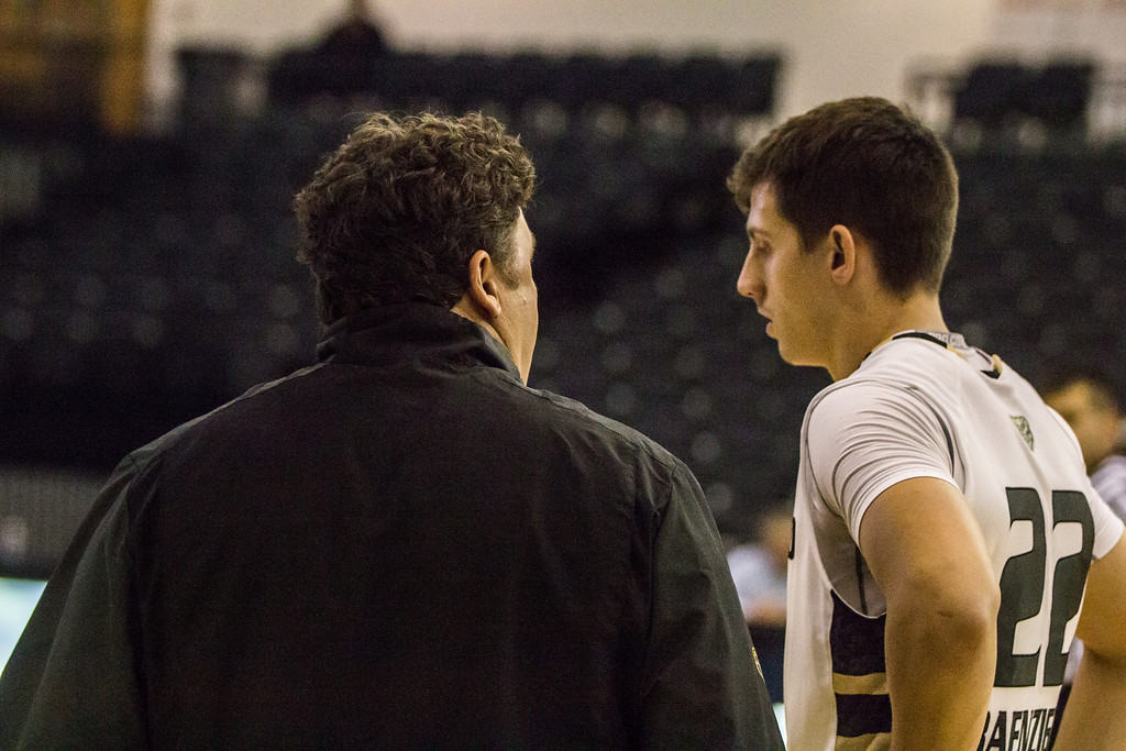 . Oakland coach Greg Kampe talks to guard Mitch Benzinger near the end of the first half Tuesday, Oct. 29, 2013 at the Athletics Center O\'rena. Photo by Dylan Dulberg