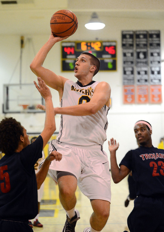 . Bishop Montgomery\'s Ognjen Miljkovic (0) puts up a shot over La Verne Lutheran\'s Ashon Provence (15) in a CIF SS Division IV-AA semifinal game in Torrance Friday night. Lutheran stunned Bishop Montgomery 63-59, ending their unbeaten season. 20130222 Photo by Steve McCrank / Staff Photographer