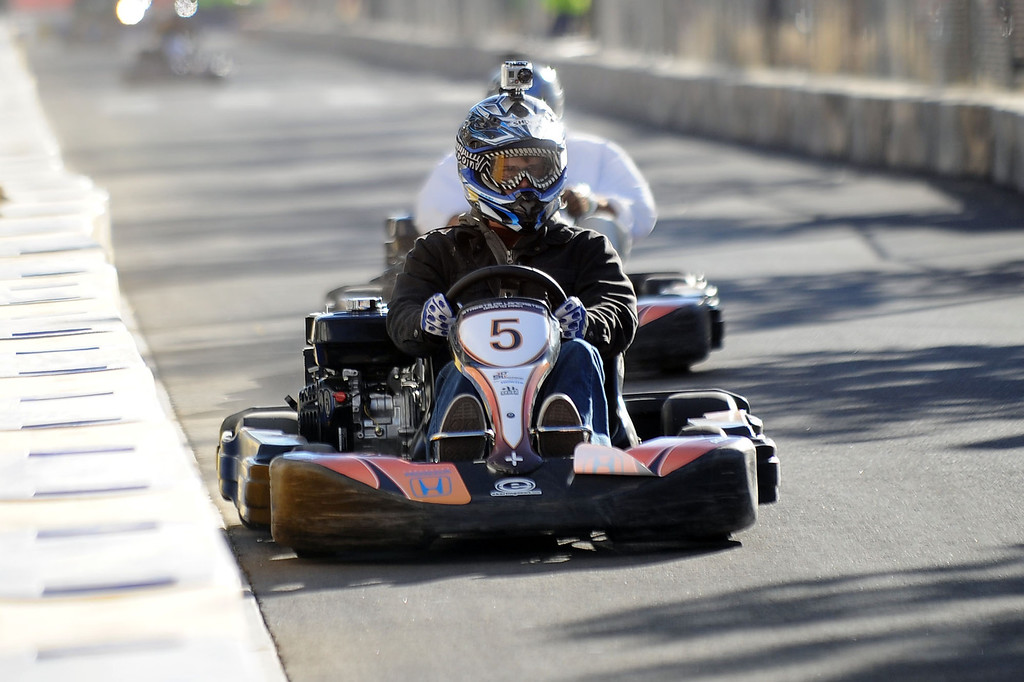 . Racers take to the streets during a practice run for the Annual Streets of Lancaster Grand Prix in Lancaster, CA September 27, 2013.  The three-day event features professional go-kart racers from across the nation and is free ot the public. (Andy Holzman/Los Angeles Daily News)