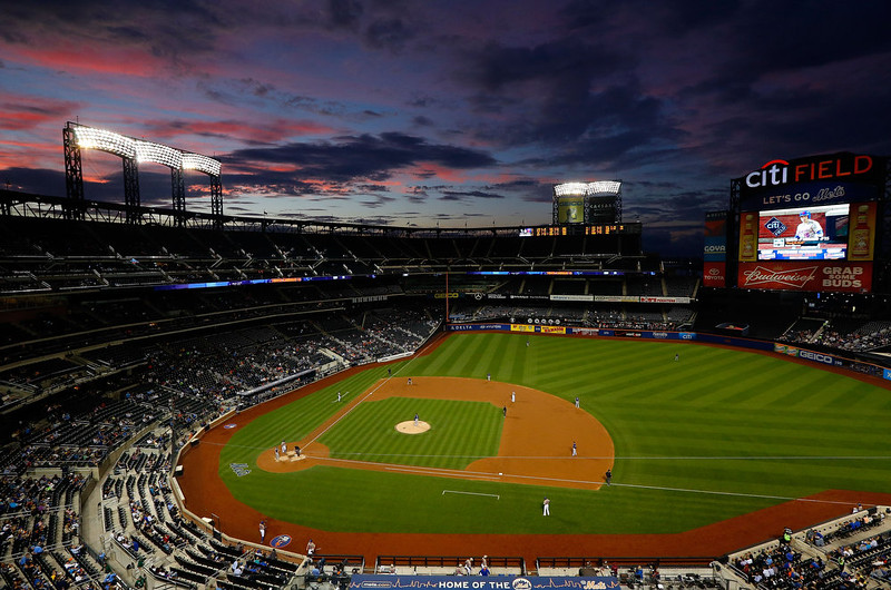 . The sun sets as the New York Mets play against the Colorado Rockies during the second inning at Citi Field on September 8, 2014 in the Flushing neighborhood of the Queens borough of New York City.  (Photo by Jim McIsaac/Getty Images)