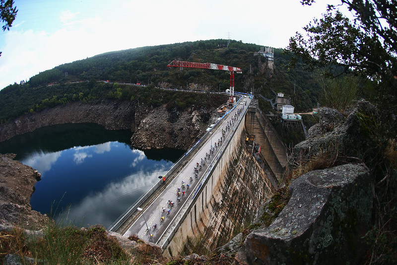 . The peloton rides over a dam during the Elite Men\'s Road Race on day seven of the UCI Road World Championships on September 28, 2014 in Ponferrada, Spain.  (Photo by Bryn Lennon/Getty Images)