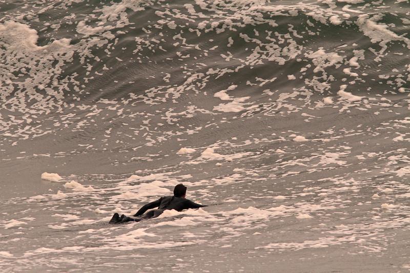 WB~paddlingoutbigwave1600.jpg