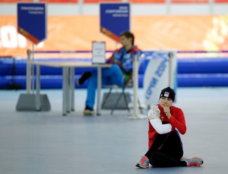 . Karolina Erbanova of the Czech Republic stretches prior to the start of the women\'s 500-meter speed skating race at the Adler Arena Skating Center during the 2014 Winter Olympics, Tuesday, Feb. 11, 2014, in Sochi, Russia. (AP Photo/Pavel Golovkin)