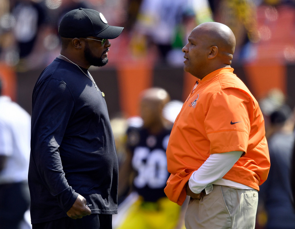 . Pittsburgh Steelers head coach Mike Tomlin, left, talks with Cleveland Browns head coach Hue Jackson before an NFL football game, Sunday, Sept. 10, 2017, in Cleveland. (AP Photo/David Richard)