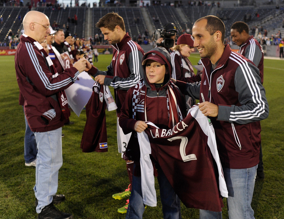. COMMERCE CITY, CO. - OCTOBER 19: Rapids players gave their jerseys to fans following the game. The Colorado Rapids defeated the Vancouver Whitecaps 3-2 at Dick\'s Sporting Goods Park Saturday, October 19, 2013. Photo By Karl Gehring/The Denver Post