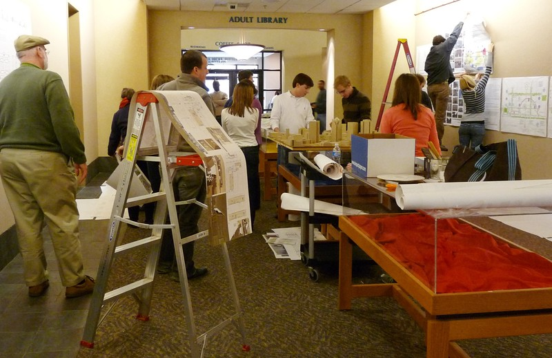 students placing the exhibits.jpg