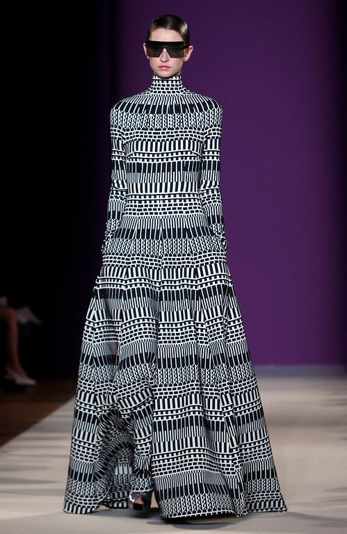 . A model wears a creation for Talbot Runhof\'s ready-to-wear Spring/Summer 2014 fashion collection, presented in Paris, Friday, Sept.27, 2013. (AP Photo/Thibault Camus)