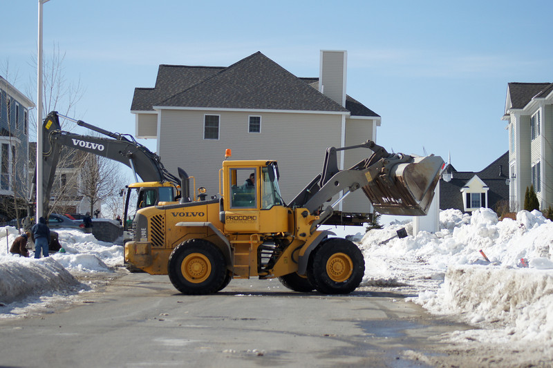 Snow job: Clearing a snow bank so a huge house can be moved