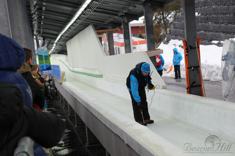 Track workers check the temperature of the ice on the luge track at the Whistler Sliding Centre before runs 1 and 2 of the men's luge competition on day 2 of the Olympics.