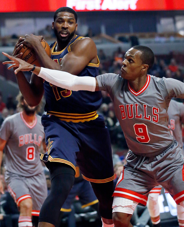 . Cleveland Cavaliers forward Tristan Thompson pulls in a rebound next to Chicago Bulls guard Rajon Rondo during the first half of an NBA basketball game Friday, Dec. 2, 2016, in Chicago. (AP Photo/Nam Y. Huh)