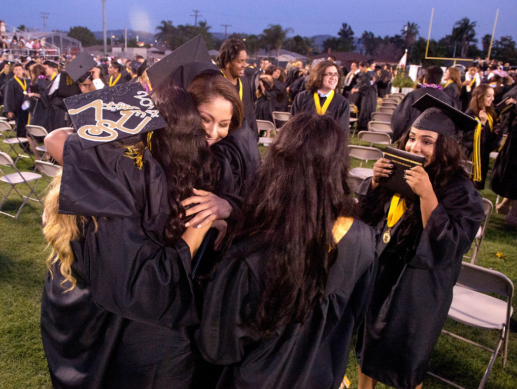 . Northview High grads hug after their commencement ceremony at Covina District Field June 11, 2014.   (Staff photo by Leo Jarzomb/San Gabriel Valley Tribune)