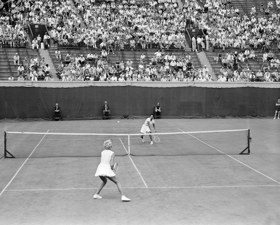 . Wimbledon champion Althea Gibson of New York sends a forehand smash toward Karol Fageros of Miami Beach, for a point during their first round match in the U.S. Tennis Championships at the West Side Tennis Club in Forest Hills, N.Y., Aug. 31, 1957.  (AP Photo/John Lindsay)