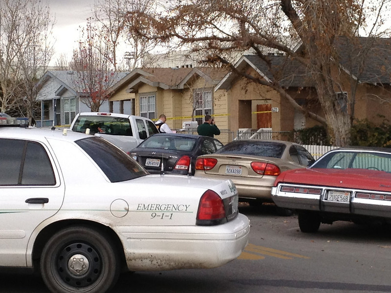 . Police search a home, at right, believed to be the home of the Taft Union High School  shooter, who shot one student, in Taft, Calif., Thursday Jan. 10, 2013. The teen victim was in critical but stable condition. The shooter was later talked into surrendering and was taken into custody.(AP Photo/Tracie Cone)