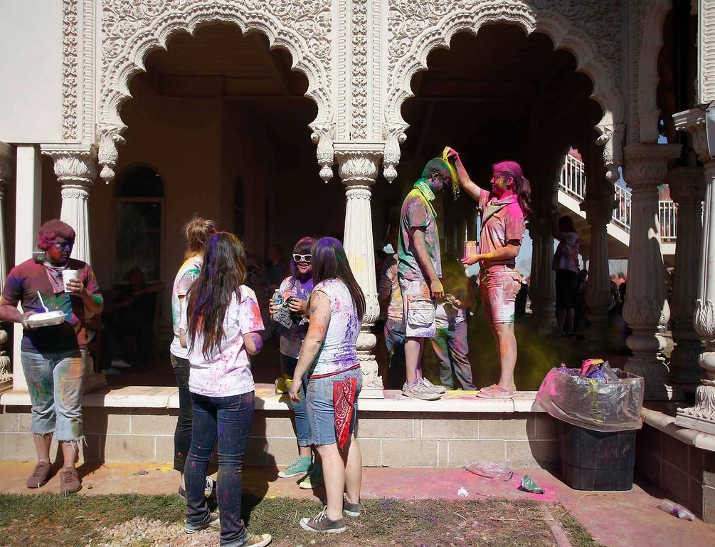 . Participants take a break during the Holi Festival of Colors at the Sri Sri Radha Krishna Temple in Spanish Fork, Utah, March 30, 2013.  REUTERS/Jim Urquhart