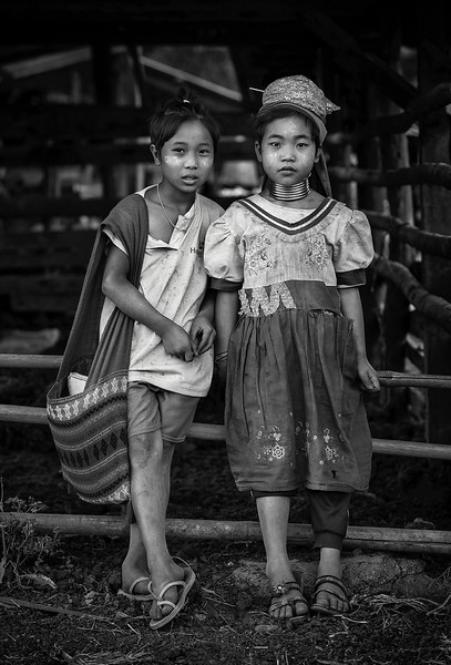 Two; girls; from; the; Kayan; tribe; on; their; way; school.  Kayah State, Myanmar 2017.