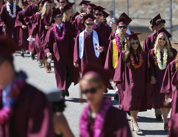 . Graduating seniors march towards their fiends and family at the Scotts Valley High football field on Wednesday afternoon during the 2013 graduation ceremony. (Kevin Johnson/Sentinel)