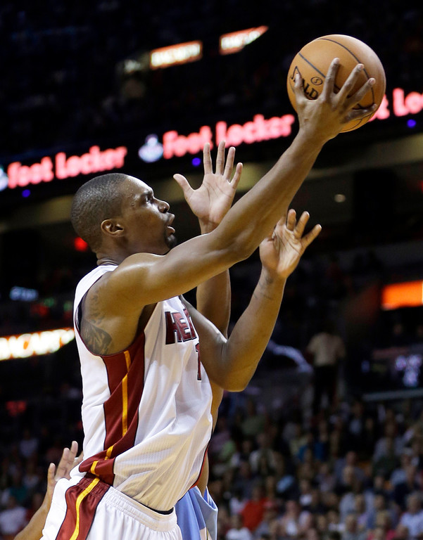 . Miami Heat forward Chris Bosh (1) goes to the basket against the Denver Nuggets  during the first half of an NBA basketball game in Miami, Friday, March 14, 2014. (AP Photo/Alan Diaz)