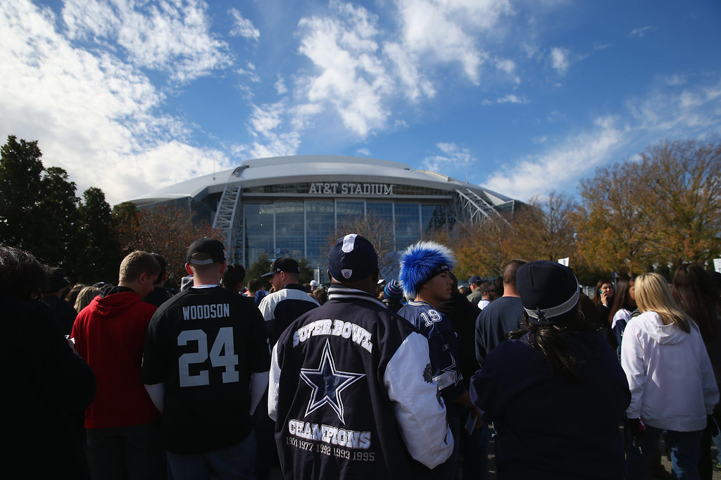 . NFL fans stand in line before a game between the Oakland Raiders and the Dallas Cowboyson November 28, 2013 in Arlington, Texas.  (Photo by Ronald Martinez/Getty Images)