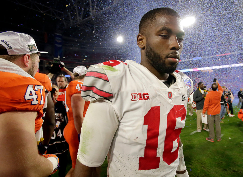 . Ohio State quarterback J.T. Barrett leaves the field after the team\'s Fiesta Bowl NCAA college football playoff semifinal against Clemson, Saturday, Dec. 31, 2016, in Glendale, Ariz. Clemson won 31-0 to advance to the BCS championship game on Jan. 9 against Alabama. (AP Photo/Rick Scuteri)