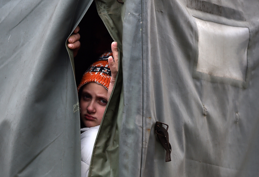 Description of . A child, evacuated from his flooded house, looks on as he rides in a army truck in the town of Obrenovac, 40 kilometers west of Belgrade, on May 17, 2014. Deadly floods across Bosnia and Serbia have claimed at least 14 lives and led to the evacuation of 15,000 people after the Balkans suffered its heaviest rainfall in a century, officials said on Saturday. In Serbia,