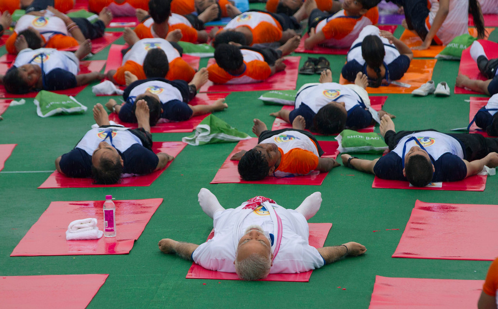 . Indian Prime Minister Narendra Modi, center, performs yoga with thousands of other Indians to mark International Yoga Day in Lucknow, India, Wednesday, June 21, 2017. Millions of yoga enthusiasts across India take part in a mass yoga sessions to mark the third International Yoga Day which falls on June 21 every year. (AP Photo/Rajesh Kumar Singh)