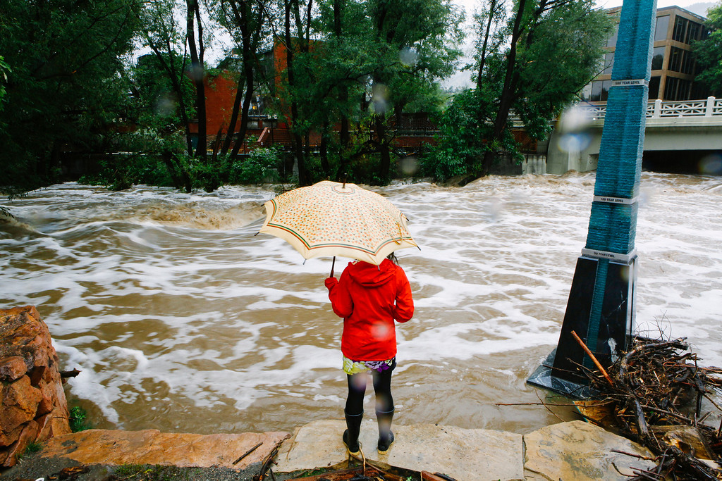 . BOULDER, CO - SEPTEMBER 12: A woman looks at Boulder Creek, which flooded early today after three days of heavy rainfall September 12, 2013 in Boulder, Colorado. An estimated 6-10 inches of rain fell in 12-18 hours and more is expected throughout the day. Flash flood sirens warned people to stay away from Boulder Creek and seek higher ground.  (Photo by Dana Romanoff/Getty Images)