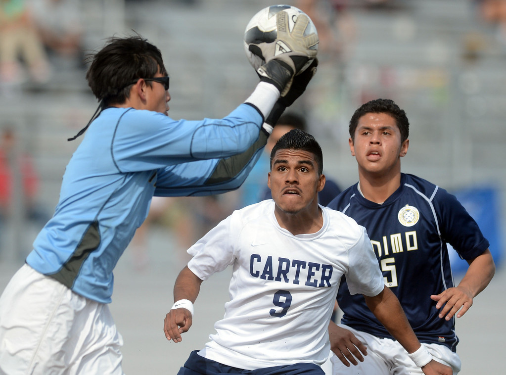 . BS03-CARTERSOCCER-06-WL (Will Lester/Staff Photographer) Carter\'s Guillermo Duran (9) tries to beat Animo goalie Celestino Cruz to a loose ball in front of net during Saturday\'s game. Carter High School falls to Animo Leadership, from Inglewood, 3-1 Saturday March 2, 2013 in the 2013 Division 6 CIF-Southern Section Boys Soccer Championship at Corona High School.