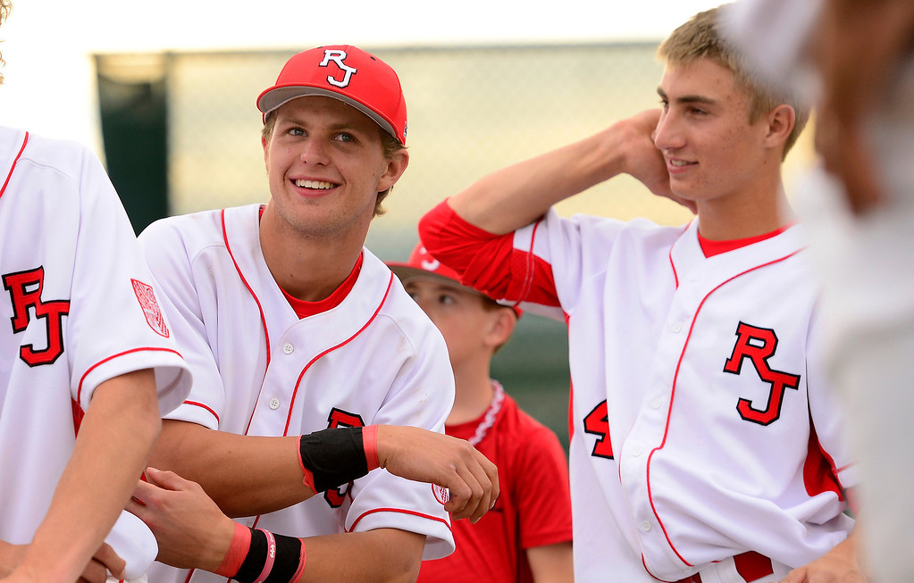 . PARKER, CO - APRIL 29: Regis Jesuit shortstop Brody Weiss and teammates listen to a post-game speech by head coach Mike Anderson follwoing the team\'s final home game. Weiss is the son of Colorado Rockies manager Walt Weiss. (Photo by AAron Ontiveroz/The Denver Post)