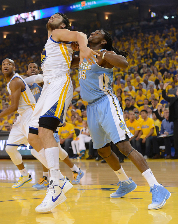 . OAKLAND, CA - APRIL 28:Kenneth Faried (35) of the Denver Nuggets battles with Andrew Bogut (12) of the Golden State Warriors under the basket during the first quarte in Game 3 of the first round NBA Playoffs April 28, 2013 at Oracle Arena. (Photo By John Leyba/The Denver Post)