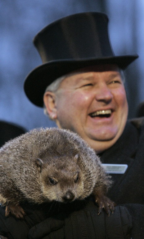 . Handler Bill Deeley smiles while holding Punxsutawney Phil, the weather predicting groundhog, after the prediction of six more weeks of winter in Punxsutawney, Pa. on Thursday, Feb. 2, 2006. (AP Photo/Keith Srakocic)