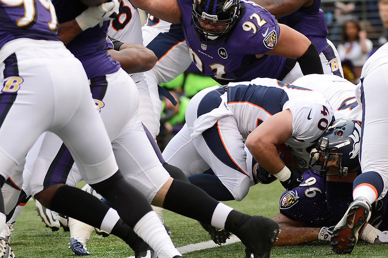 . Denver Broncos running back Jacob Hester #40 drives in for a touchdown in the first half against the Baltimore Ravens at the M&T Bank Stadium, in Baltimore , MD Sunday December 16, 2012.      Joe Amon, The Denver Post
