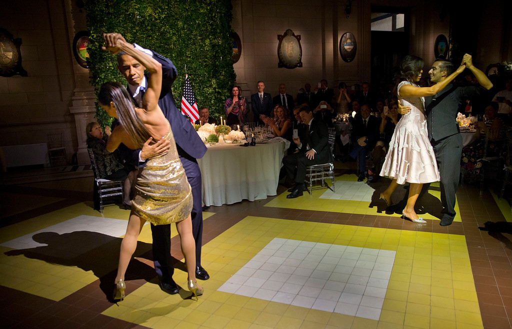 . President Barack Obama and first lady Michelle Obama, right, dance the tango with tango dancers during the State Dinner at the Centro Cultural Kirchner, Wednesday, March 23, 2016, in Buenos Aires, Argentina. (AP Photo/Pablo Martinez Monsivais)