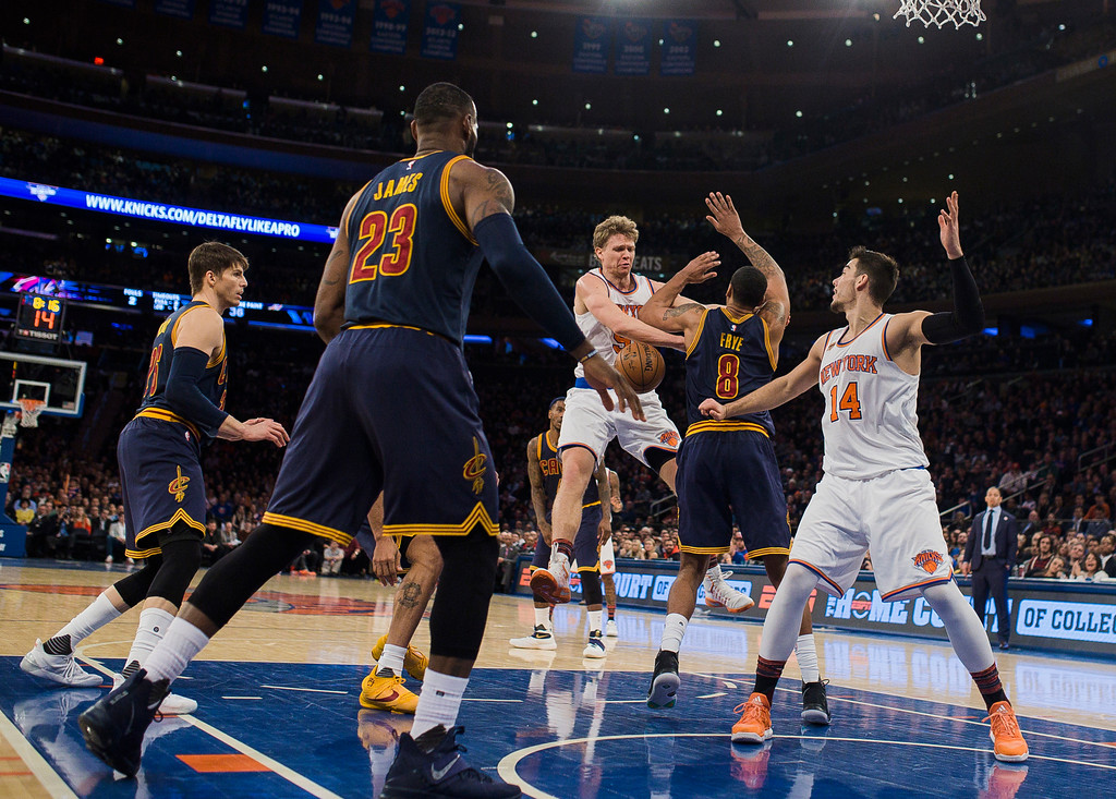 . New York Knicks\' Mindaugas Kuzminskas, top center, competes for the ball with Cleveland Cavaliers\' Channing Frye (8) during the second half of an NBA basketball game Saturday, Feb. 4, 2017, in New York. (AP Photo/Andres Kudacki)