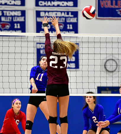 10/11/2019 Mike Orazzi | StaffrSt. Paul's Olivia Genovese (11) and Torrington's Sydney Bermas (23) during Thursday night's girls volleyball match in Bristol.