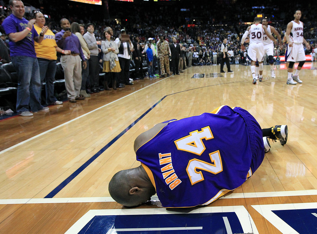 . Los Angeles Lakers guard Kobe Bryant lays on the floor after being injured in the final seconds of an NBA basketball game against the Atlanta Hawks on Wednesday, March 13, 2013, in Atlanta. The Hawks defeated the Lakers 96-92.  (AP Photo/Atlanta Journal-Constitution, Curtis Compton)