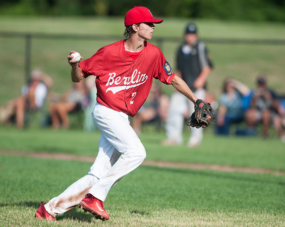 07/24/18 Wesley Bunnell | Staff Berlin Legion baseball vs Moosup on Tuesday afternoon at Sage Park. Camden Murphy (2) fields and throws to home for the out.