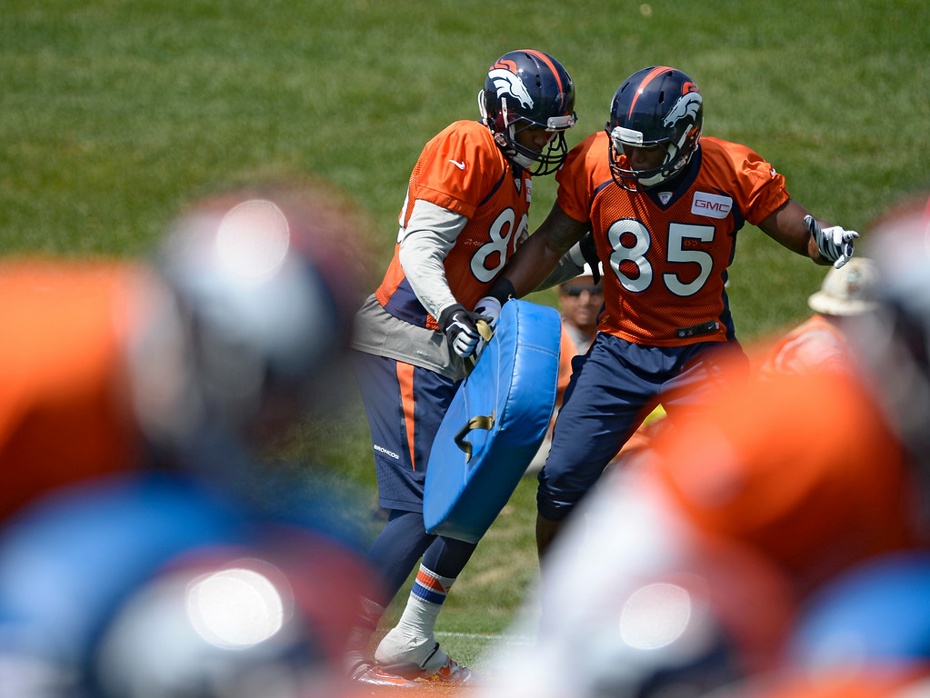 . Denver Broncos tight end Julius Thomas (80) and Denver Broncos tight end Virgil Green (85) work on drills during day two of the Denver Broncos 2014 training camp July 25, 2014 at Dove Valley. (Photo by John Leyba/The Denver Post)