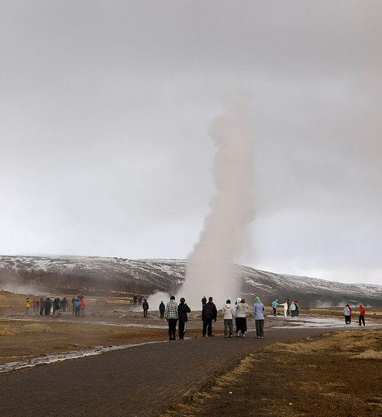 The fantastic huge geysers at Geysir and Strokkur. The Strokkur erupts every 5-10mins. Some explosions fill the sky whilst others rumble up much quiter. Fascinating to see the energy thrown up from these hot springs. Crowd of people watching on. Olympus E3, 12-60mm SWD