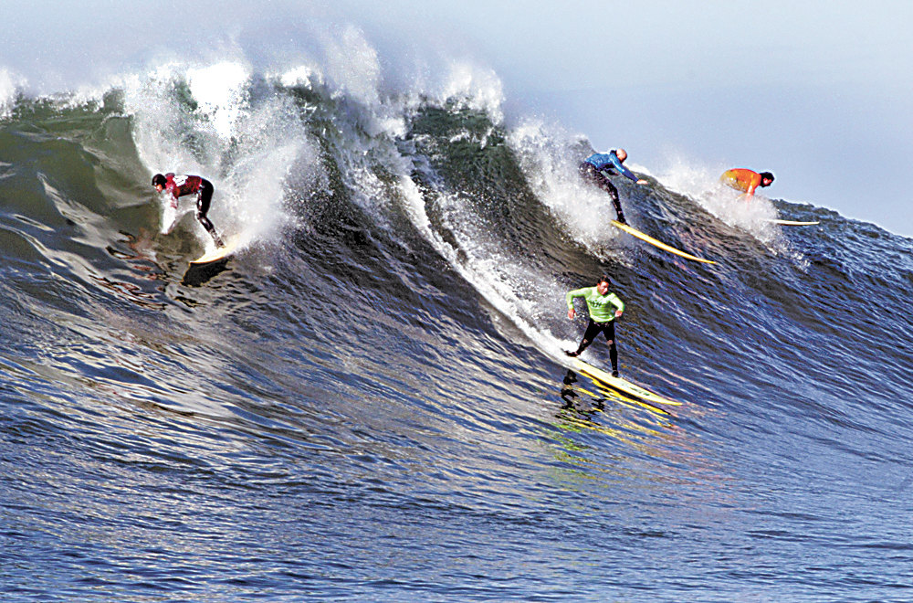 Description of . Desparate for a good scoring wave, Ryan Seelbach and Santa Cruz surfers Anthony Tashnick, Tyler Smith and Shane Desmond scramble for position on this wave in the semifinal heat of the 2008 contest.  (Dan coyro/Sentinel)