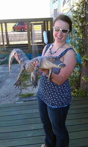 Ellen holds an alligator